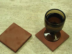 'panther sandstone coasters' from the web at 'http://coasters.pebblez.com/beverage-coasters/../pictures/ruby/240/ruby-coasters-1.jpg'